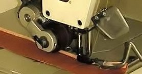 Carpet overlocking machine